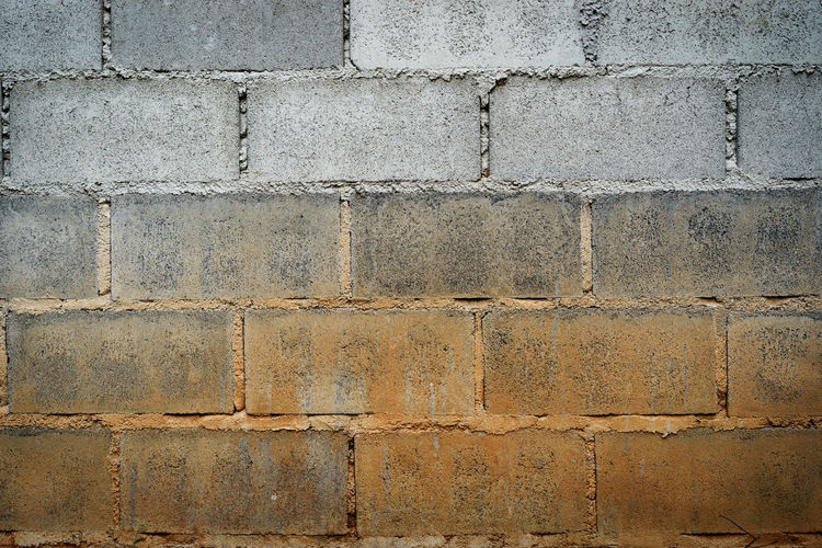 Architecture Backgrounds Brick Brick Wall Built Structure Close-up Concrete Day Full Frame Gray In A Row No People Old Outdoors Pattern Repetition Rough Solid Stone Wall Textured  Wall Wall - Building Feature