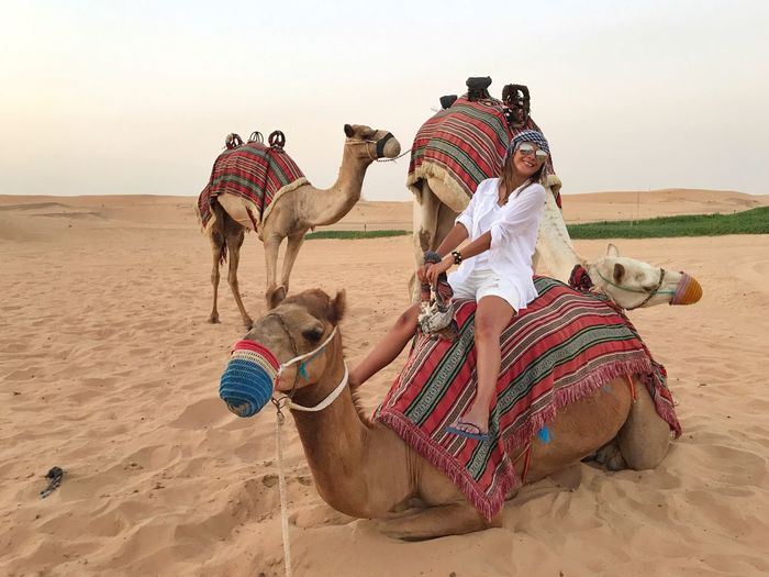 People riding horse in desert