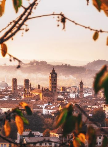 Church Church Architecture City Cityscape Fog Sunset EyeEm Best Shots Focus On Background No People Travel Destinations Nature Sky Outdoors Tourism Tree Travel Italy Light And Shadow Selective Focus City Life Autumn Leafs EyeEmNewHere EyeEm Selects Langhe