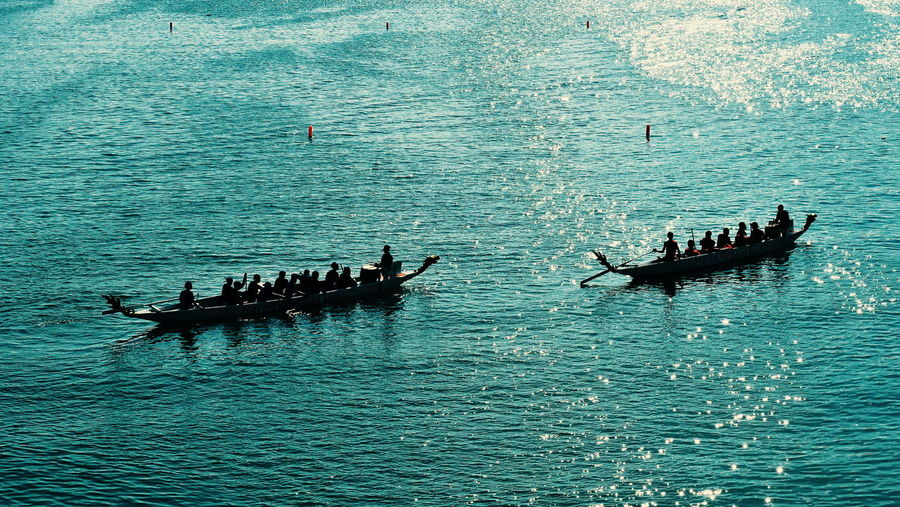 Group of people in boat on sea