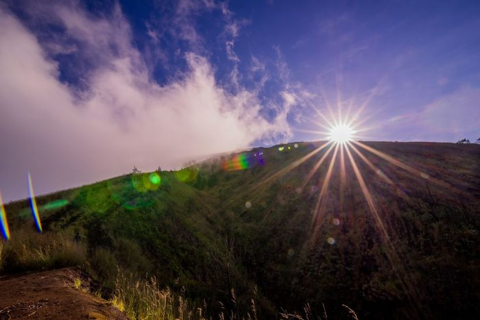 sunbeam over mountain Beauty In Nature Day Grass Landscape Mountain Nature No People Outdoors Scenics Sky Sunbeam Sunlight Sunrise Sunset Tranquil Scene Tranquility