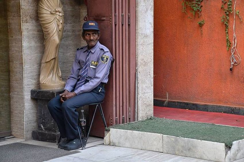 "A security guard on his duty, his behaviour is significant by the body language and the expressions he is giving… You can also see the bottle under the chair where he is sitting, which he's used to drink water. After clicking this image, the security guard saw me & gave me a strict look and told me ""hey bro, why u clicking my pictures, go somewhere else"" 😆 Streetsofindia _soi Streetphotography Hauzkhazvillage India SecurityGuard People Incredibleindia Indiaclicks Sodelhi Yehdelhihai Dilli DelhiDairies Instapic Instagram Photojournalism Photography Everydayeverywhere Worldwide Everydaylife Dailylife Everydaydelhi Discoverindia NETGEO Photooftheday shotinIndia street"