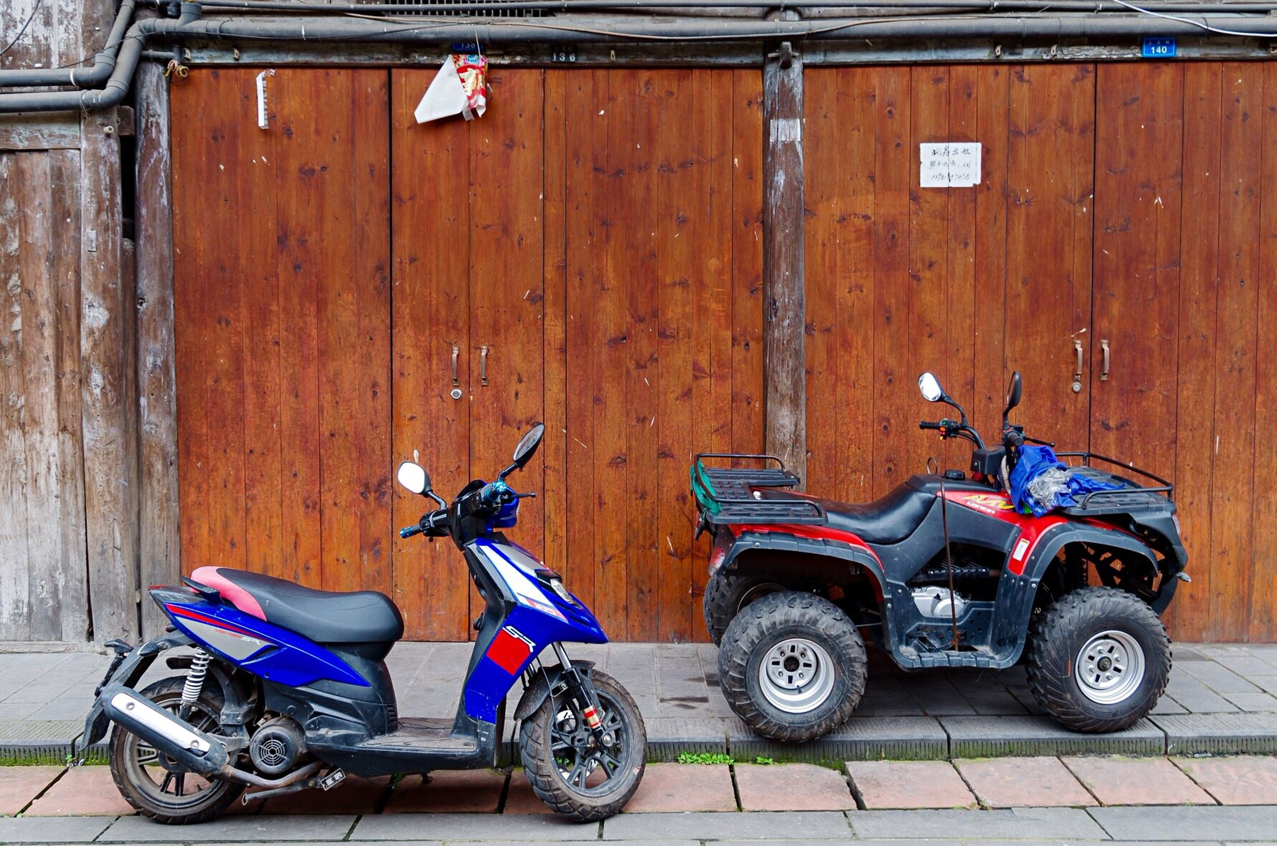 land vehicle, mode of transport, stationary, parking, parked, day, outdoors, no people, parking lot, blue