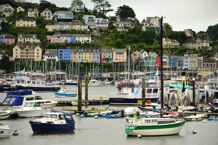 Colourful houses at Kingswear, Devon, by River Dart Architecture Boat Built Structure Canal City City Life Color Colors Colour Colourful Colours Day Harbor In A Row Kingswear Mode Of Transport Nature Nautical Vessel Outdoors Side By Side Sky Travel Destinations Water