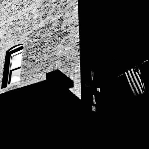 The Street Photographer - 2017 EyeEm Awards The Architect - 2017 EyeEm Awards Built Structure Architecture Building Exterior Wall - Building Feature Shadow Low Angle View Silhouette Brick Brick Wall