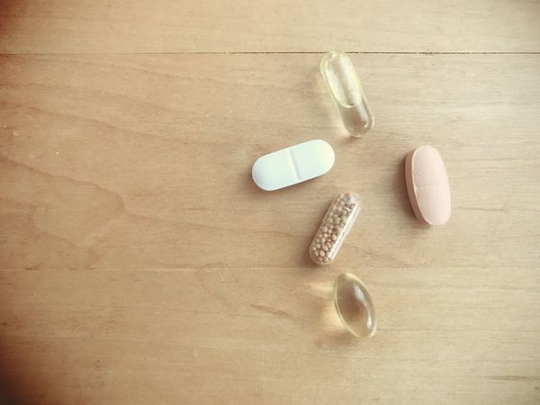 Tablets and vitamins on wood background with copy space Nobody Copy Space Omega 3 Fatty Acids Fatty Acids Omega 3 Vitamin Tabletten Medicine Pill Medicine Indoors  Still Life Dose High Angle View Healthcare And Medicine No People Table Variation Directly Above Wood - Material Choice Capsule Nutritional Supplement Group Of Objects Close-up