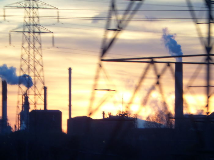 Silhouette.. Sunset. Architecture Built Structure Chimneys. Close-up Day Electricity  Electricity Pylon Fuel And Power Generation Industrial Landscape. No People Outdoors Power Line  Power Supply Silhouette Smoke. Sunset Technology