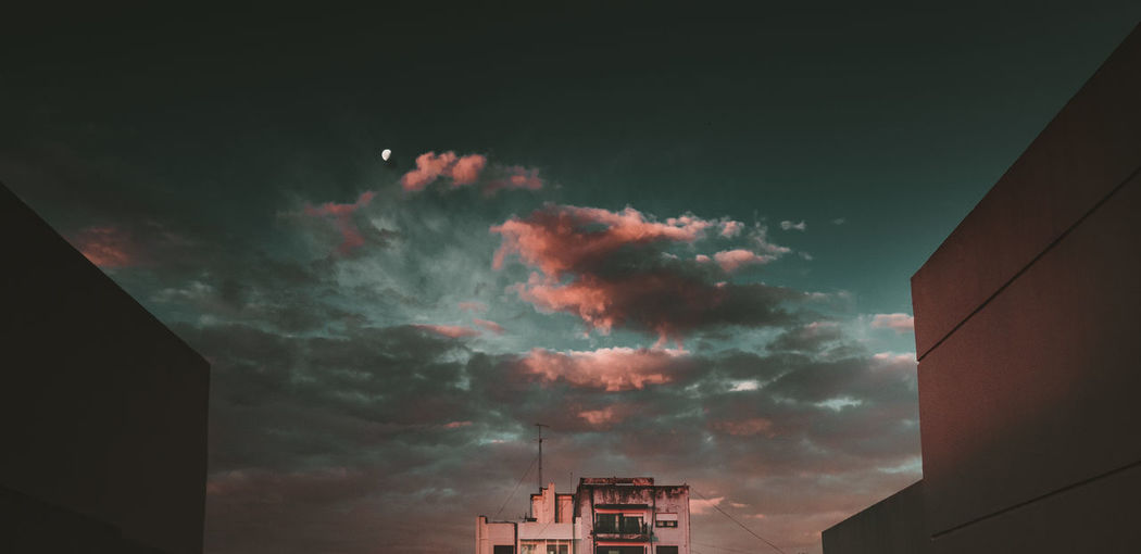 Sky Cloud - Sky Building Exterior Architecture Built Structure Nature Building No People Low Angle View Outdoors Beauty In Nature City Communication Industry Night High Section Sunset Scenics - Nature Environment Pollution