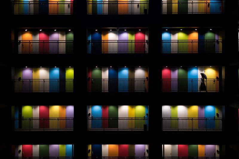 Full frame shot of illuminated glass building at night