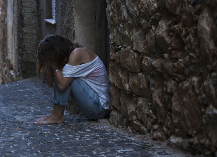 Real People One Person Day Stone Wall Depression - Sadness Sadness Depression Violence Domestic Violence Domestic Violence Survivor Survivor Beating  Sexism Husband Crying Hopelessness Hopless Desperate Desperation Abuse Abused Abused Women Sexual Harassment Victim Silence Shame Injustice Hurt Young Women