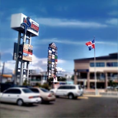 Nofilter Iphone3g Iphonegraphy Lovetiltshift parkinglot cars flag sky clouds street