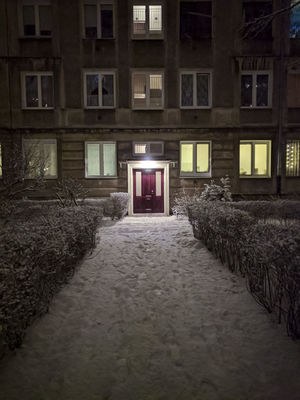 A snowy path in the city Architecture Building Exterior Illuminated Night Outdoors Snow Snow Covered
