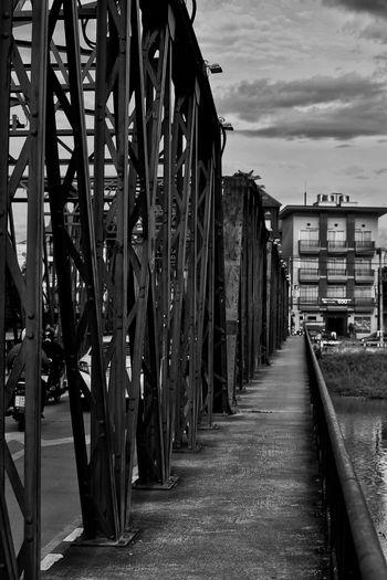 View of bridge amidst buildings against sky