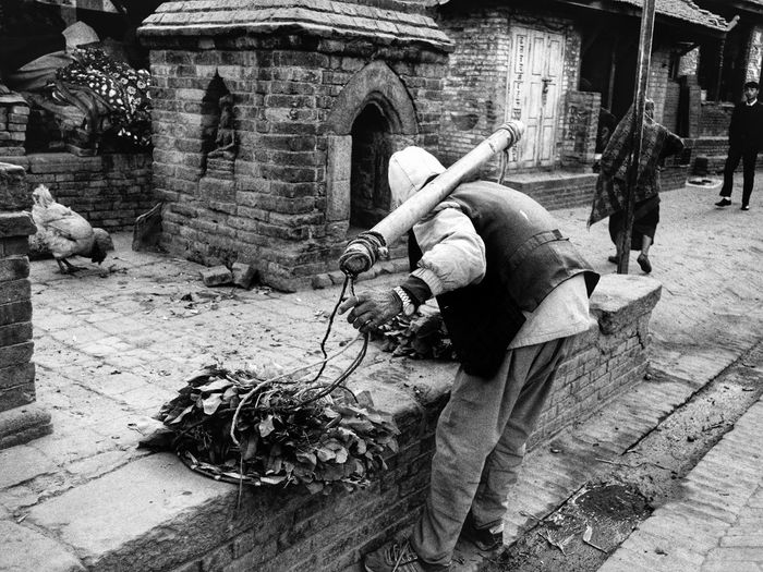 Rear view of people working at historical building