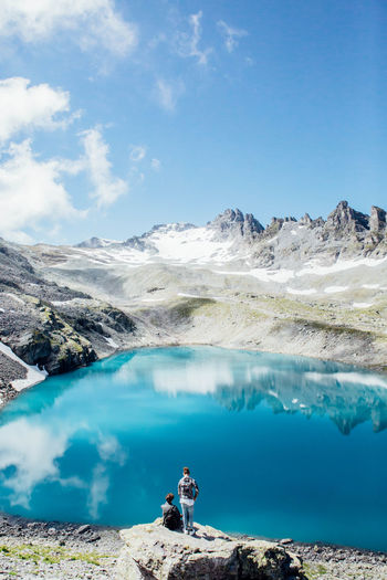 View Adventure Beauty In Nature Blue Exploration Hike Lake Lifestyles Men Mountain Mountain Range Nature Outdoors Scenics Sky Summer Switzerland Togetherness Tranquil Scene Tranquility Two People Water