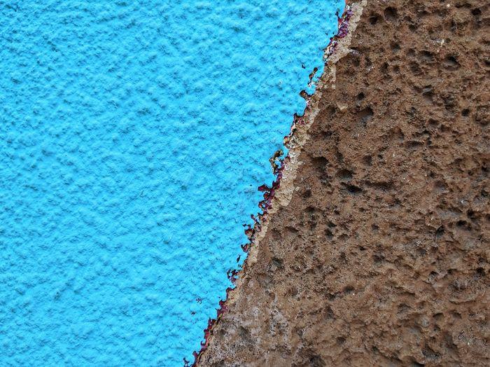 High angle view of blue sea shore