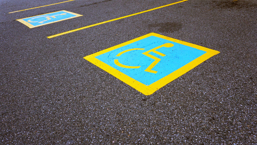 Parking Spot Asphalt No People Outdoors Road Wheelchair Wheelchair Access Wheelchair Sign Yellow