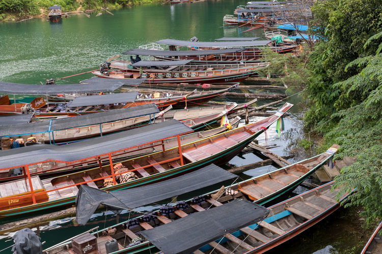 High angle view of long tail boats in water