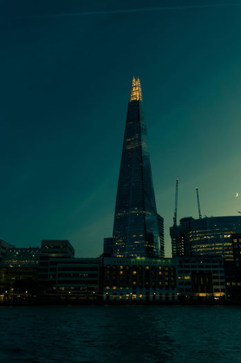 London Shard at early evening Building Exterior Built Structure Architecture Sky City Water Waterfront Tall - High No People Illuminated Travel Destinations Clear Sky Night Dusk Office Building Exterior Outdoors Skyscraper Modern Cityscape Spire  Luxury London Shard River Thames
