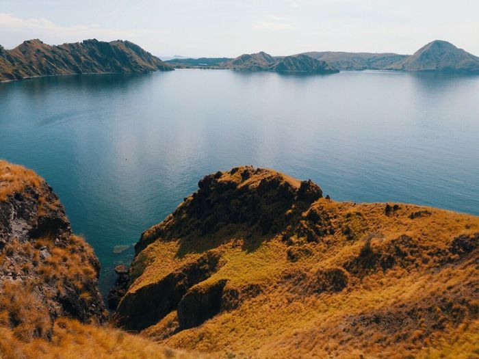 Iamonmywaytoeverywhere Traveling Ocean INDONESIA Labuan Bajo Island Komodo Island Rinca Island Water Scenics - Nature Beauty In Nature Sky Nature Rock Beach