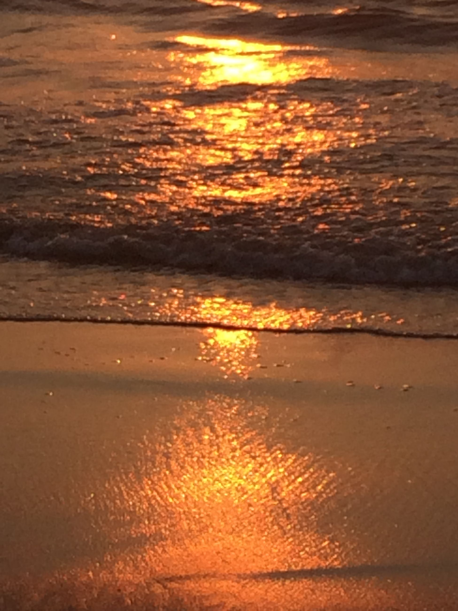 water, sunset, sea, beach, orange color, reflection, scenics, beauty in nature, tranquil scene, tranquility, nature, horizon over water, shore, sand, idyllic, sunlight, outdoors, rippled, sky, wet
