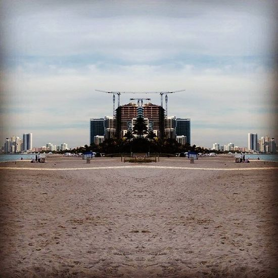 Reflecting on beach in Miami as dreams are built up ahead 📷 on ZTE Axon Surfside Surfside Beach Balharbour USA Miami, FL Miami Beach Miamibeach Bal Harbour Mirror Picture Florida Outdoors Urban Geometry Mirror Architecture Beach