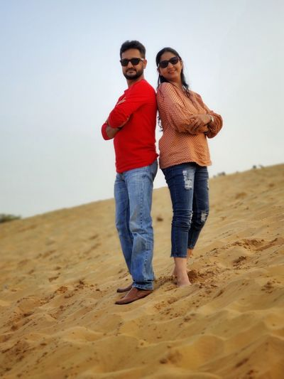 Full length of young couple on beach