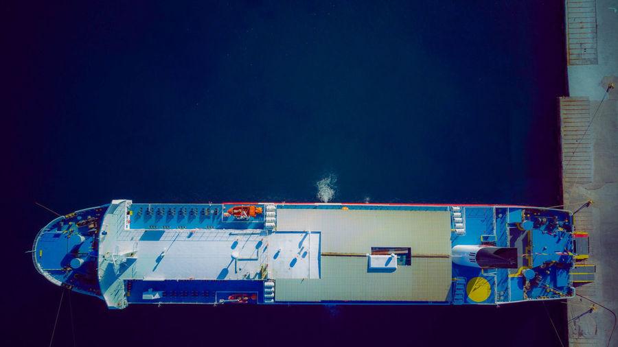 Digital composite image of illuminated building against blue sky