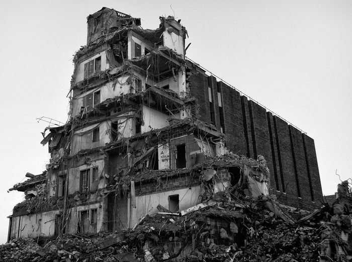 Low angle view of old demolished building