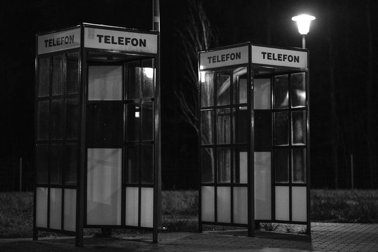 The era of empty phone booths. [39/365] 2016.11.17 I was busy all day with the quest of moving to capital city of Poland, and since I've only managed to take this picture during a stop on the A2 highway to Warsaw. Architecture Built Structure Communication Highway Night No People Outdoors Parking Lot Phone Phone Booth Phonebooth Two