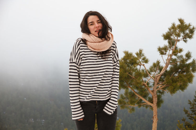 Portrait Of Young Woman Wearing Striped Top During Foggy Weather