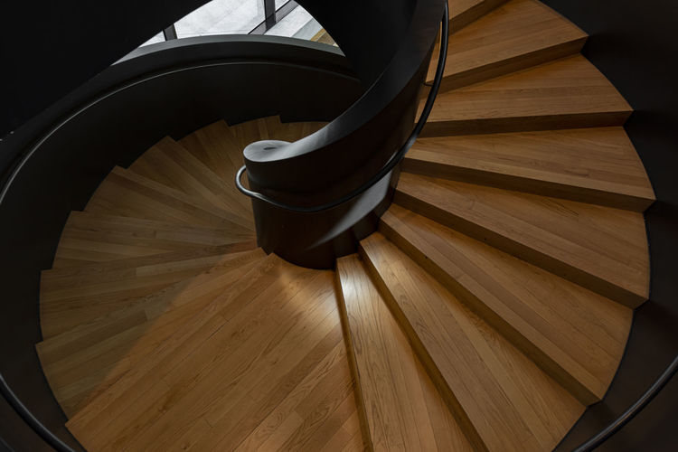 Indoors  High Angle View Architecture Steps And Staircases No People Staircase Wood Wood - Material Built Structure Spiral Spiral Staircase Railing Hardwood Floor Pattern Flooring Metal Empty Absence Home Interior Brown