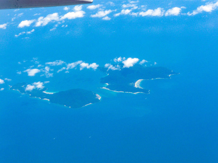ISLANDS IN THE SEA Aerial View Seen From The Aeroplane Window ıslands In The Ocean Water Sea Life Sea Satellite View Underwater Blue Backgrounds Close-up Sky Airplane Wing Aeroplane