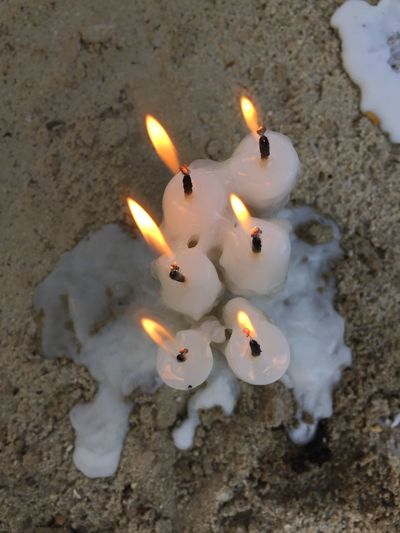 Candle Easter Candle Christmas Candle Christmas Time Easter Christmas Lights Festival Season Festival Fire Flame Burning Candle Heat - Temperature Fire - Natural Phenomenon Illuminated Glowing No People Melting Celebration Environment Event Land Indoors  Wax High Angle View Close-up