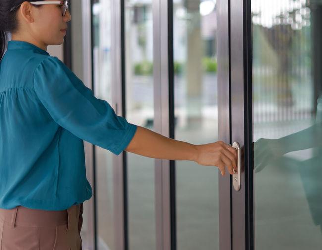 Close-Up Of Woman Opening Door