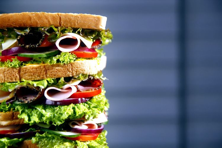 tall and big meat and vegetable sandwich Food Bread Sandwich Meat Ham Salami Cokdccuts Tomato Vegetable Lettuce Cheese Snack Meal Lunch Dinner Breakfast Health Healthy Eating Diet Nutrition Delicious Taste Flavor Ingredient Cafe Diner Restaurant DeliciousFood  Dish mealtime