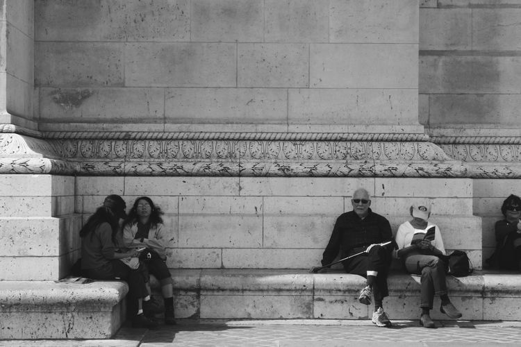 Paris Real People People Day Adults Only People And Places People Sitting People Reading Architecture Monument France Exploring Traveling City Travel Photography Paris Paris, France  Arch De Triomphe Togetherness Blackandwhite Photography Blackandwhite Black & White Elegant Black & White Details Ornaments EyeEmNewHere The Street Photographer - 2017 EyeEm Awards Modern Love