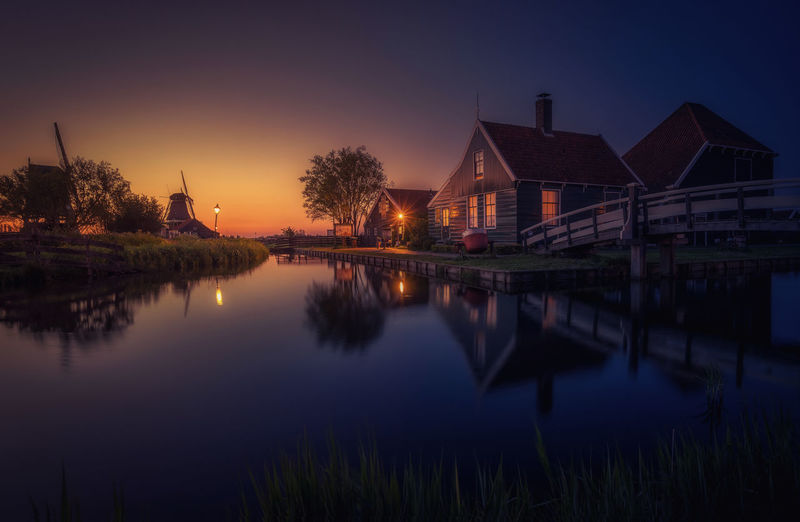 Remo SCarfo Zaanse Schans Architecture Building Building Exterior Built Structure Holding House Illuminated Lake Nature Night No People Plant Reflection Sky Sunset Tranquil Scene Tranquility Tree Water Waterfront