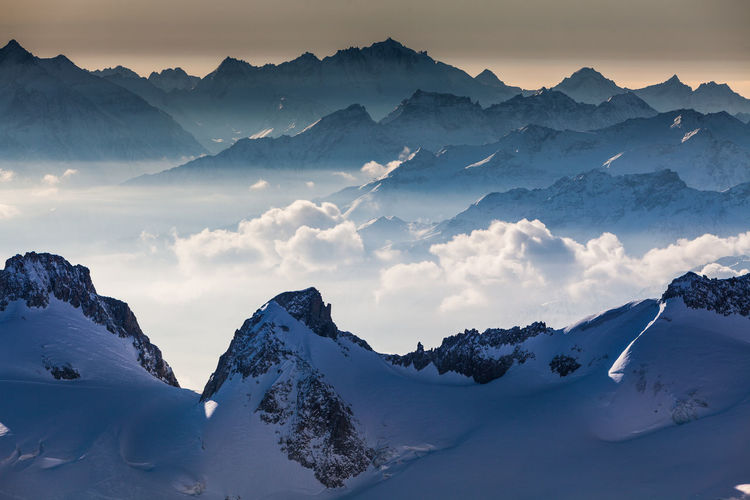 View from Aguille du Midi France, Alps Aguille Du Midi France Beauty In Nature Cold Temperature Day Frozen Idyllic Landscape Mountain Mountain Range Nature No People Outdoors Scenics Sky Snow Snowcapped Mountain Sunset Tranquil Scene Tranquility Weather Winter
