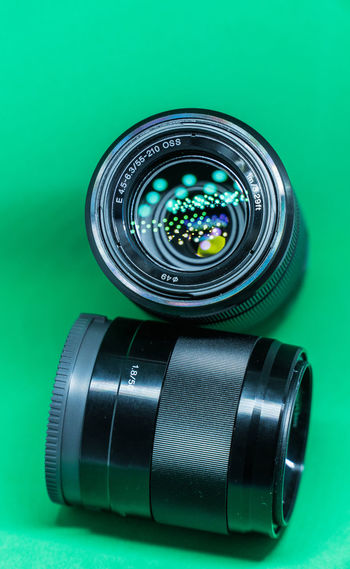 Close-up of camera lens on green background