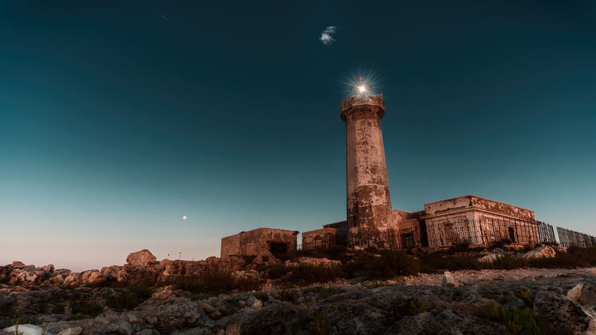 Ancient Ancient Civilization Architectural Column Architecture Building Exterior Built Structure Clear Sky History Illuminated Lightohouse Low Angle View Moon Moonlight Nature Night No People Outdoors Rock Rock - Object Rock Formation Scenics - Nature Sky Solid The Past Travel Destinations