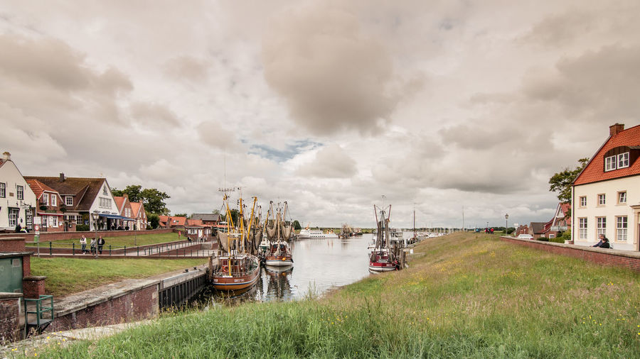 Boats On River Against Cloudy Sky At Werdum