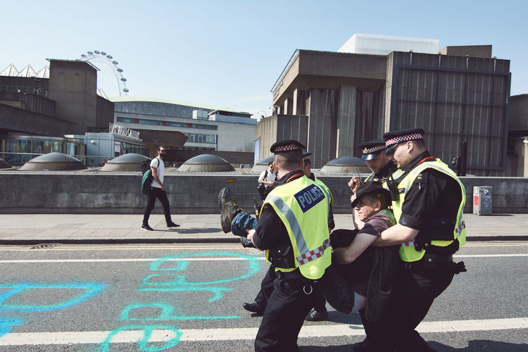 Extinction Rebellion - London 2019 Extinction Rebellion Protest Protesters London Group Of People Building Exterior Men Architecture Built Structure City Group Medium Group Of People Real People Day Sunlight Street Sky Males  People Women Nature Adult Child Standing Outdoors Government Uniform