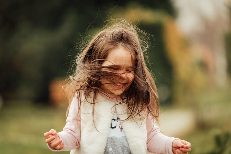 Cute happy girl playing outdoors