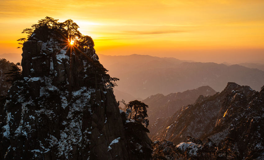 Mountain Sky Sunset Beauty In Nature Scenics - Nature Tranquil Scene Orange Color Mountain Range Rock Tranquility Non-urban Scene Rock - Object Nature Solid Idyllic Mountain Peak Environment Rock Formation No People Cloud - Sky Outdoors Formation Huangshan Yellow Mountain Sunrise China