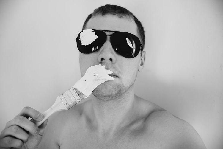 Close-Up Portrait Of Shirtless Man Holding Paintbrush