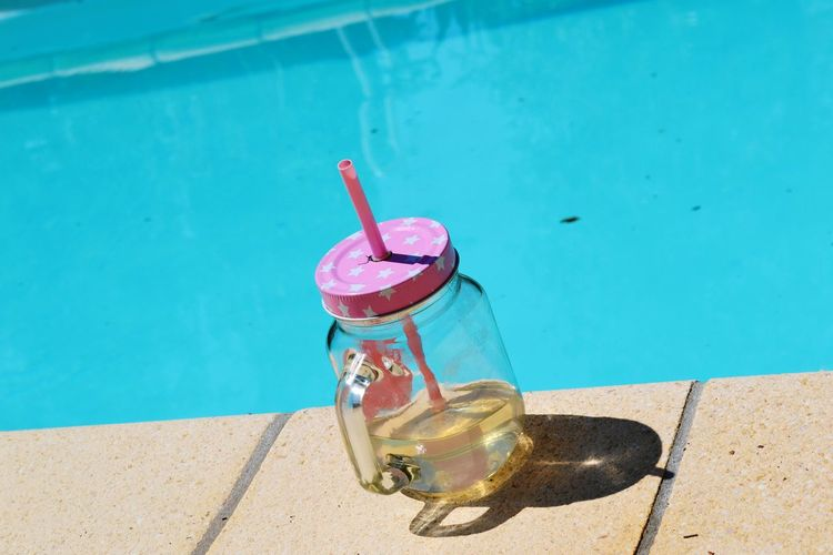Eyeemlife Drinking Glass Drink Summertime Lazy Day Water Swimming Pool Shadow Beach Red Summer High Angle View Sunlight Poolside