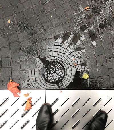 High Angle View Human Body Part Real People Low Section Body Part One Person Personal Perspective Street Directly Above Unrecognizable Person Men Shoe Day Human Hand City Hand Paving Stone Outdoors Human Foot Lookingup Lookingdown Reflection Autumn Puddleography