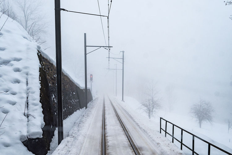 Winter Snow Cold Temperature Railroad Track Rail Transportation Weather Transportation Fog Snowing White Color Frozen Shades Of Winter
