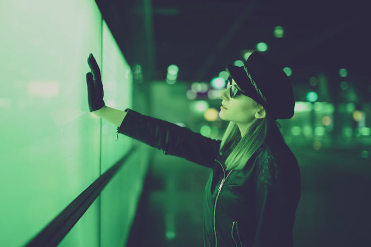 Side view of woman touch the future